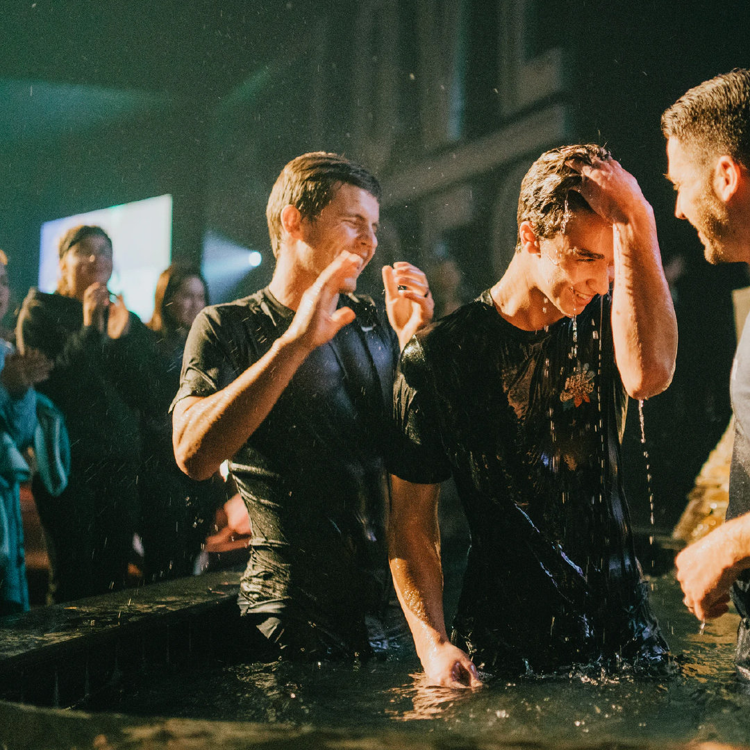 Young adults being baptized